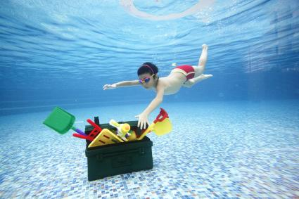 Boy Diving For Toy box Underwater