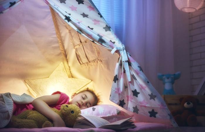 Girl napping in the tent
