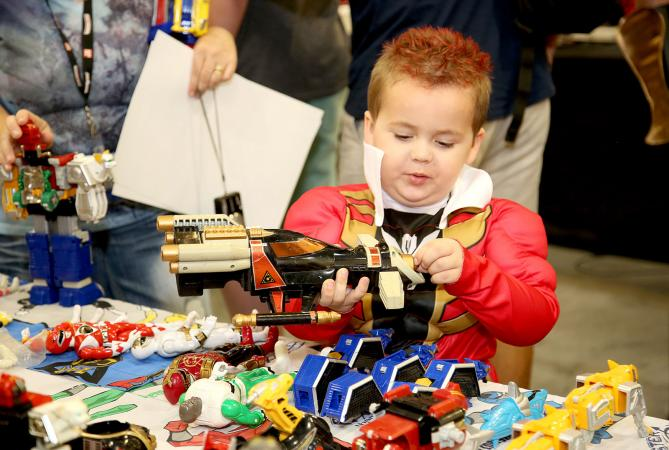 Boy looking at Power Ranger toys