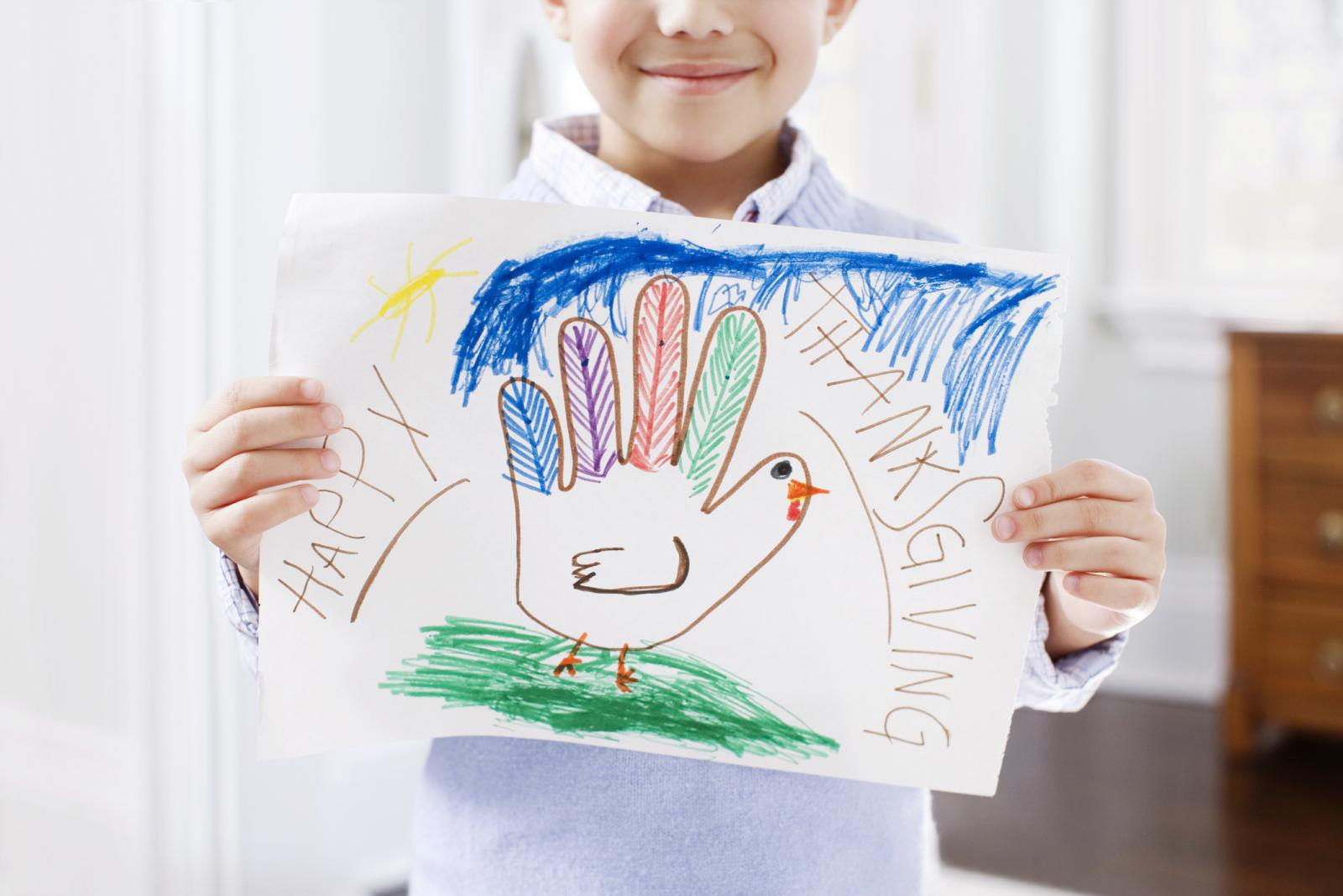 Boy with thanksgiving drawing