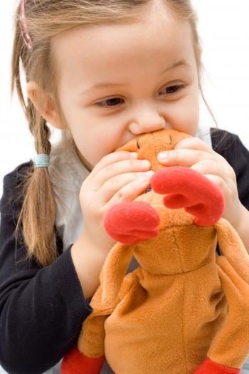 girl with stuffed reindeer