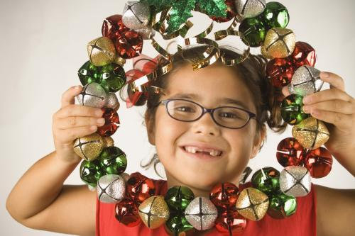 girl holding a holiday wreath