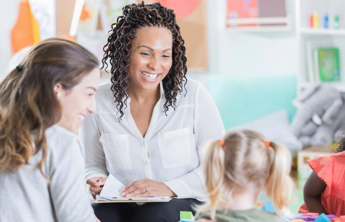 Preschool teacher talking to parents