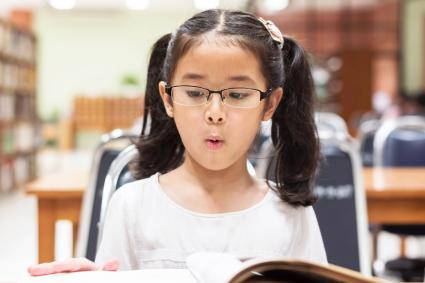 Student learning and reading book in library