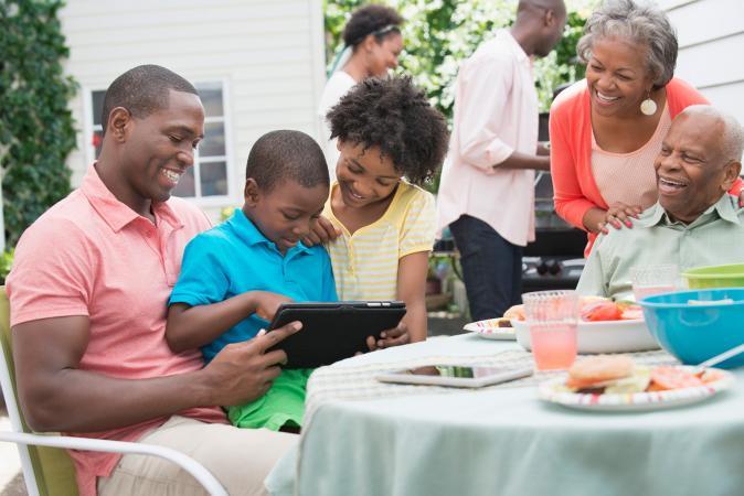 family looking at photos at bbq