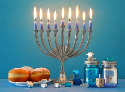 Hanukkah menorah and candles on table