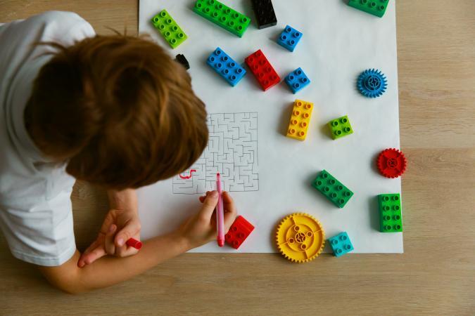 child solving a maze
