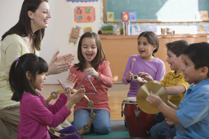 kids playing percussion instruments in class