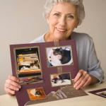 woman holding up scrapbook page