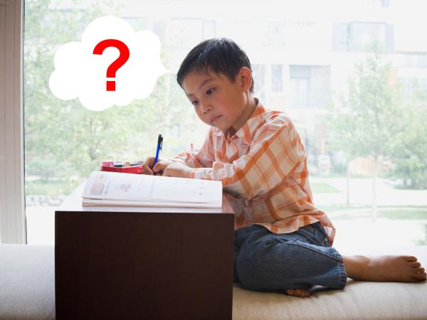 Boy doing creative guessing game