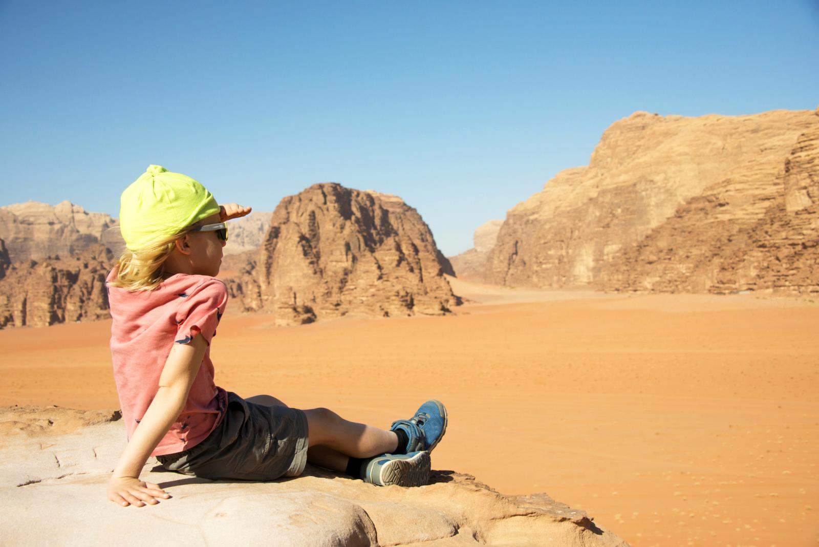 Boy in desert landscape of Wadi Rum