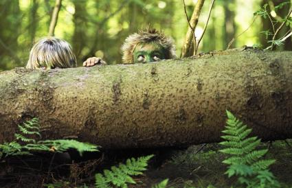 Boys hiding in the forest