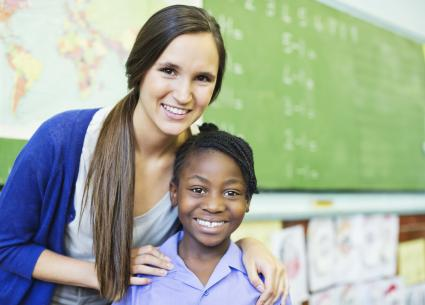 Student and teacher smiling in class