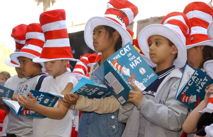 Children read from The Cat in the Hat book