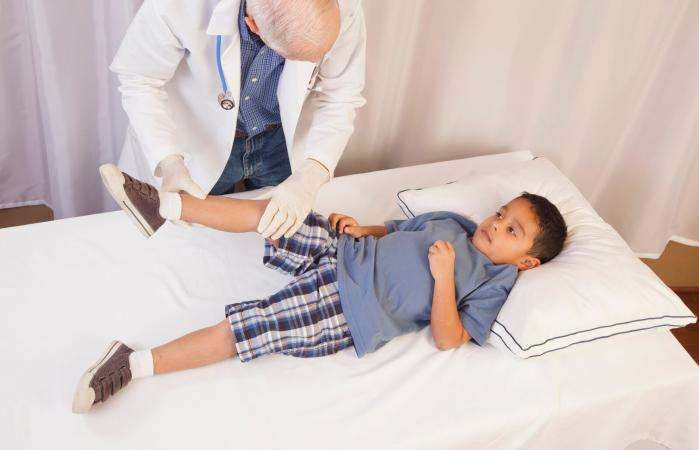boy in doctor's office on exam table
