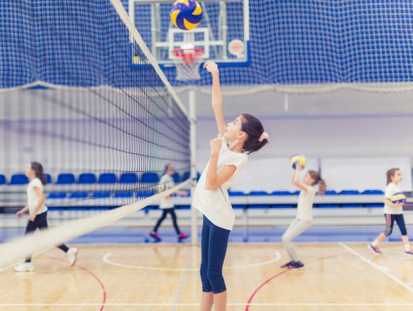 Female volleyball having training on volleyball court