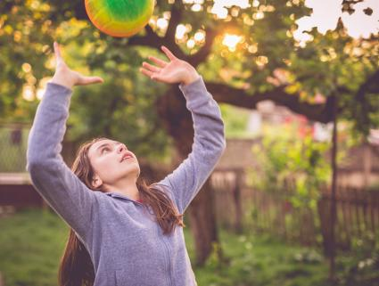 Girl playing volleyball setting up