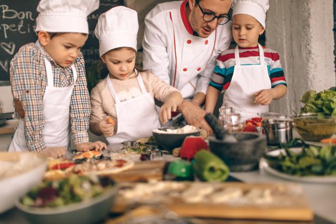 Father teaching kids to cook