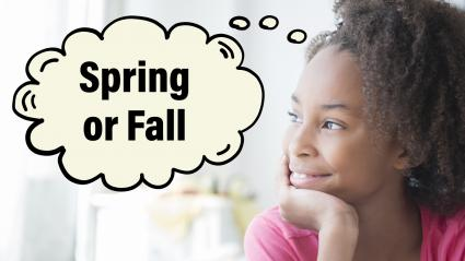 Girl looking out window thinking about spring or fall