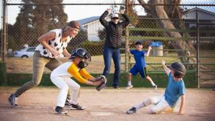 Family members playing baseball