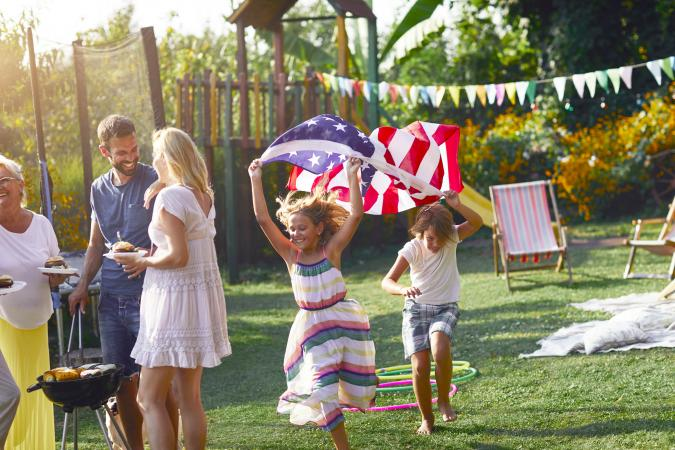 Adults and kids at 4th of July party