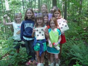 Rockbrook campers posing in the woods