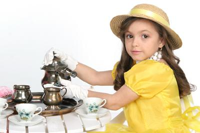Image of a little girl having a tea party