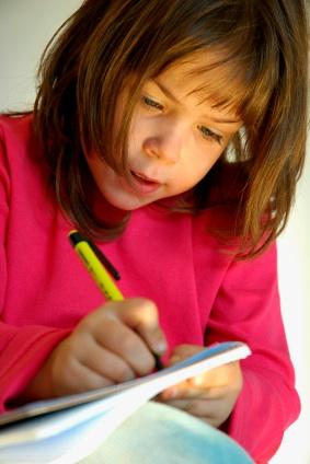 Girl writing a letter to her pen pal