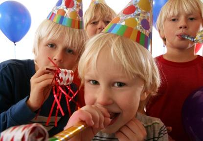 Kids at a birthday party blowing noise makers