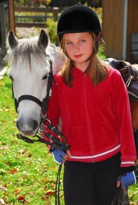 Little equestrian at a girls' summer camp
