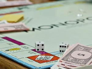 Image of a fun and educational Monopoly game in progress