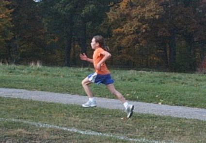 Preteen boy running a track and field event
