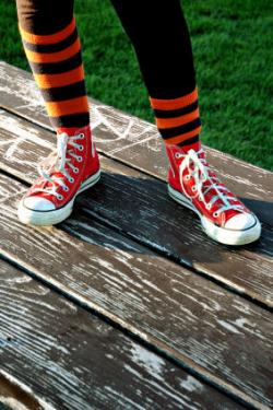 Child in striped socks and sneakers