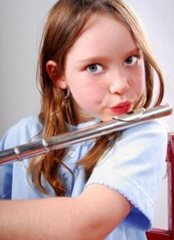 Elementary age girl playing flute