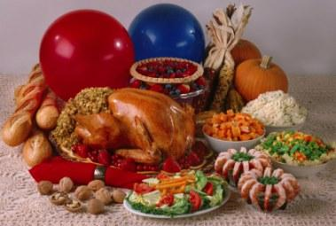 A Thanksgiving dinner with turkey, vegetables, bread, and pie