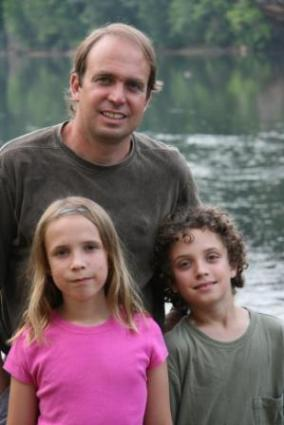 Dr. Rick Van Noy and children at the river