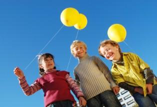 Kids with balloons on a treasure hunt