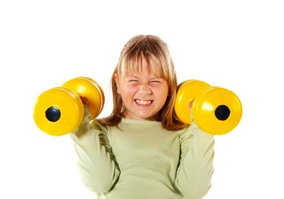 Young girl lifting yellow dumbbell weights