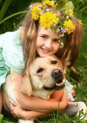 A girl hugging her dog.