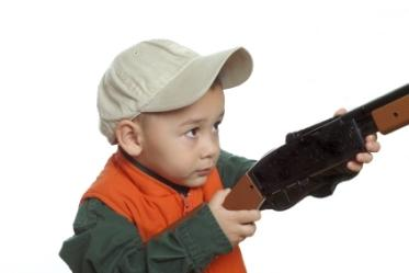 Little boy holding a gun
