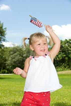 Young girl waving American flag
