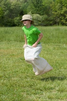 Boy in a sack race