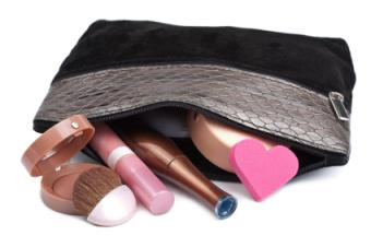 Small, zippered makeup bag and cosmetics