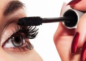 closeup of woman applying mascara