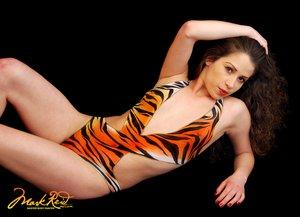 Painted swimsuit created by Mark Reid of Enchanted Body Art.