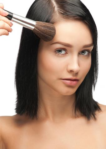 Woman applying bronzer with brush