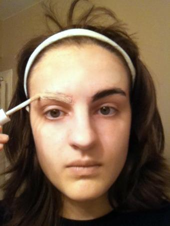 plastering down eyebrows