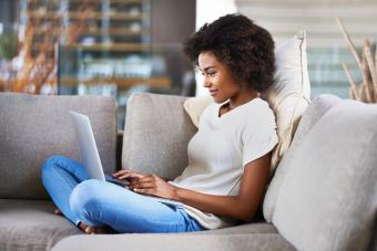 woman on sofa using a laptop