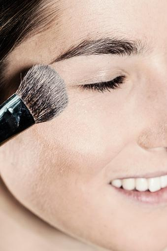 face powder being applied near eye