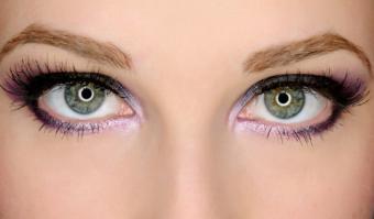 purple make up on green eyes